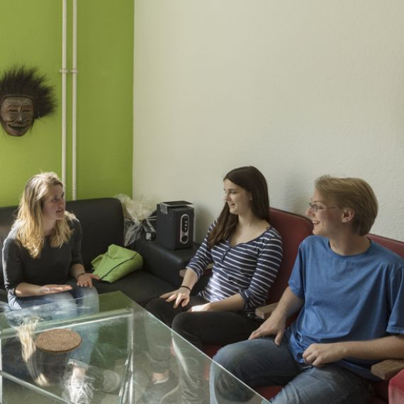 students sitting in residence hall