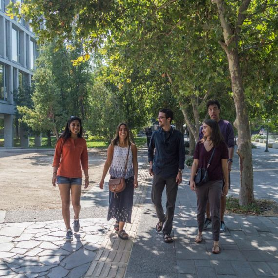 students walking on campus of Pontifica Catolica University