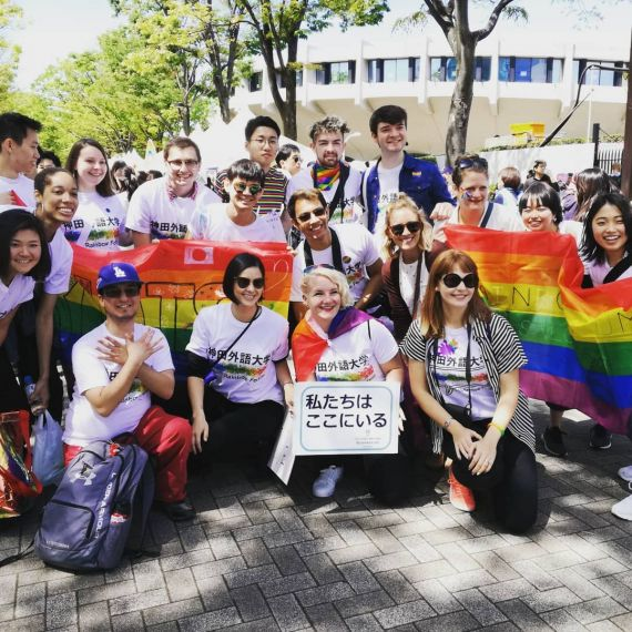students holding pride flags and signs in Tokyo, Japan