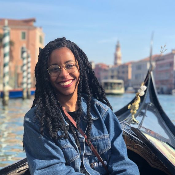Yazmin Baptiste sitting on a boat