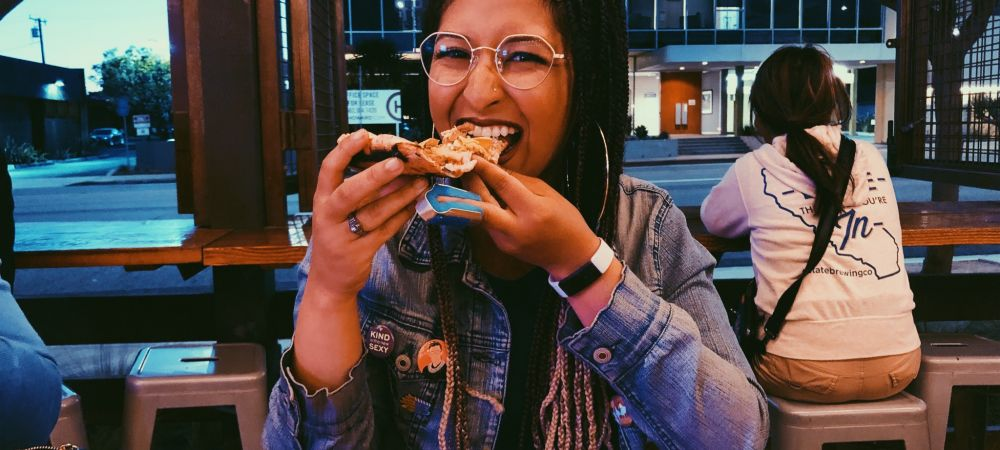Milan Study Abroad Girl Eating Pizza