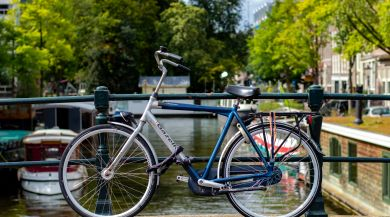 Bike Parked on a Small Canal Bridge