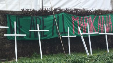 """Crosses on UCT campus with a sign reading """"We Are All Marikana"""""""