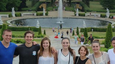 Students smiling in Berlin in front of fountain