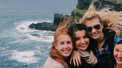 four dublin study abroad students at cliffs of moher