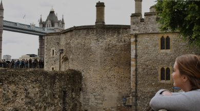 student looking at the Tower of London and Tower Bridge