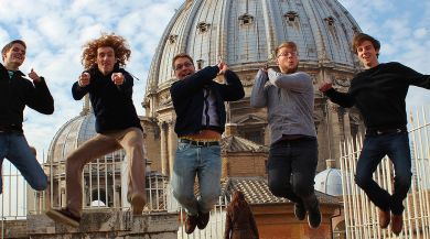 Five Rome study abroad students jumping in front of a dome