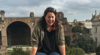 Rome study abroad student sits on ledge