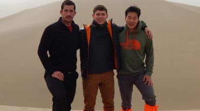 Shanghai study abroad students in front of sand dunes