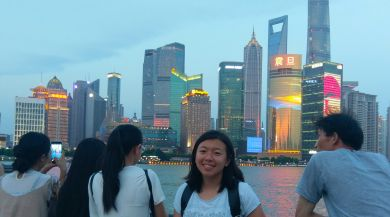Intern in China in front of Shanghai skyline at dusk