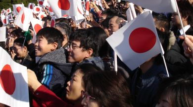 Tokyo locals waving Japanese flags