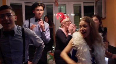 students dressed up and dancing at a party