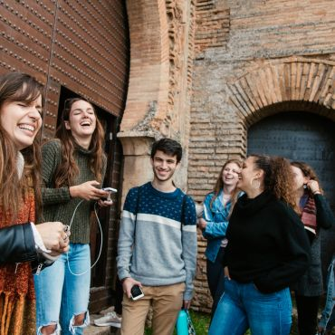 students in a group laughing