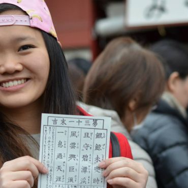 student holding paper with chinese mandarin characters