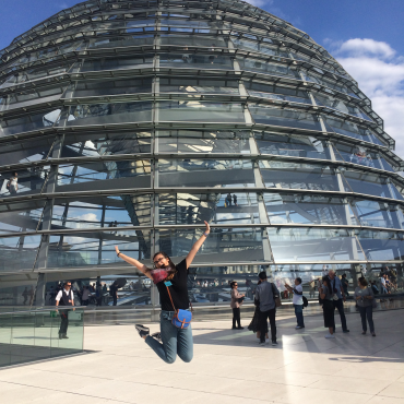 Intern jumping in front of Reichstag dome