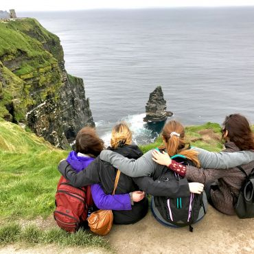 Watching the view at the Cliffs of Moher