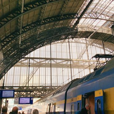 NS Train Arrives at Centraal Station