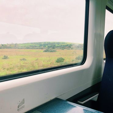 View looking out the window of a train in Ireland