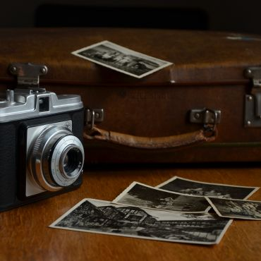 Stock photo of old camera, suitcase