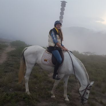 Riding horses around the Catequilla ruins in the Pomasqui Valley