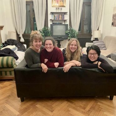 Me and my friends on a couch in their apartment in Vienna
