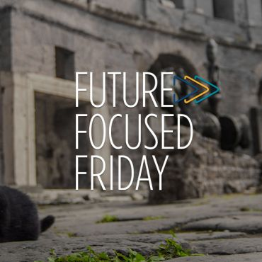 """Black cat in street with """"Future Focused Friday"""" logo in center"""