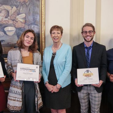 Dr. Mary M. Dwyer and four student award winners holding certificates