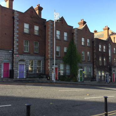 Brick row houses with colorful doors in Dublin