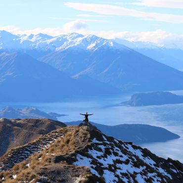 Student standing on ledge at Roys Peak in New Zealand