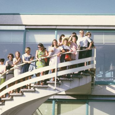 IES Abroad Vienna students 1967-68 standing on a staircase