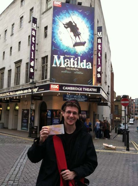 Student in front of the Cambridge Theatre