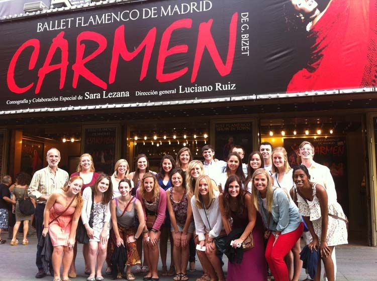 Students in front of sign for Carmen