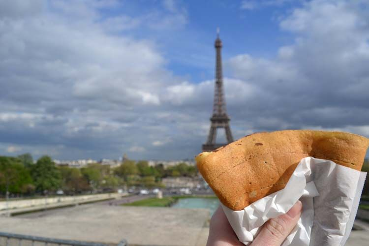 Holding a crepe by the Eiffel Tower