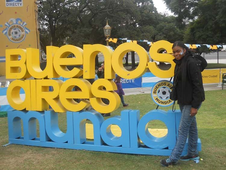 Student by Buenos Aires soccer sign