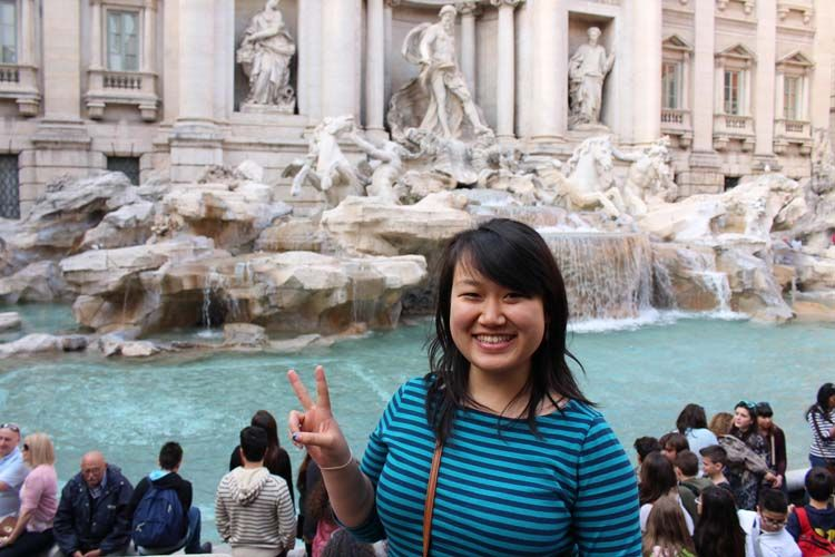 Student posing in front of Trevi Fountain