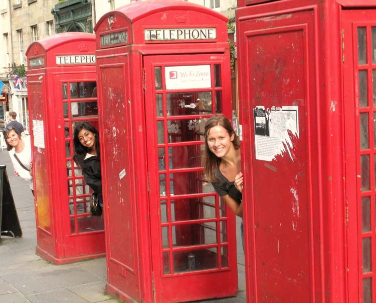 Students having fun by phone booths in London