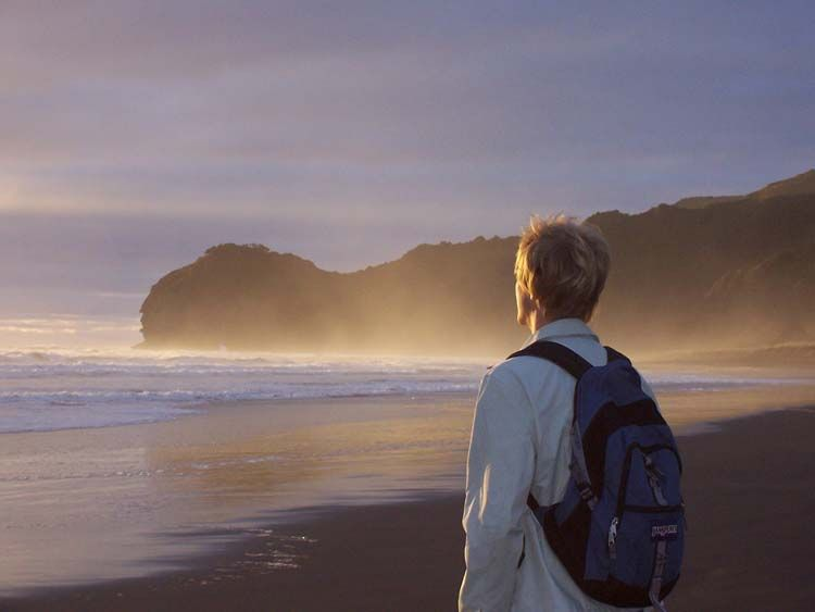 Student gazing at the ocean