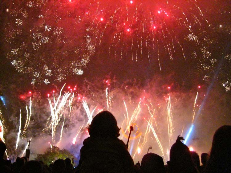 Students watch a fireworks display