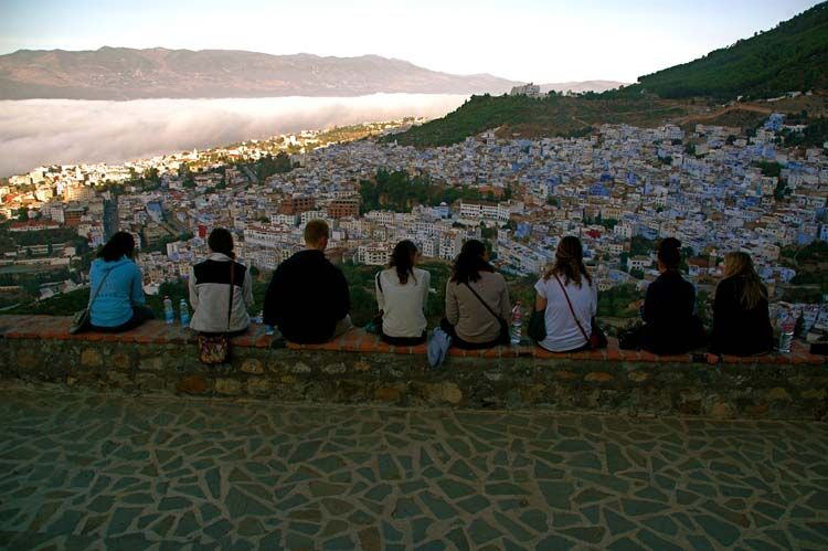 Line of students looking over the city