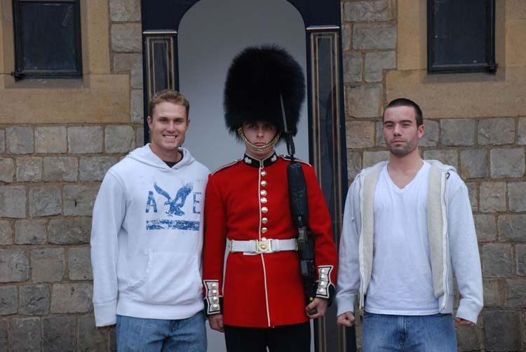Students posing with a London guard