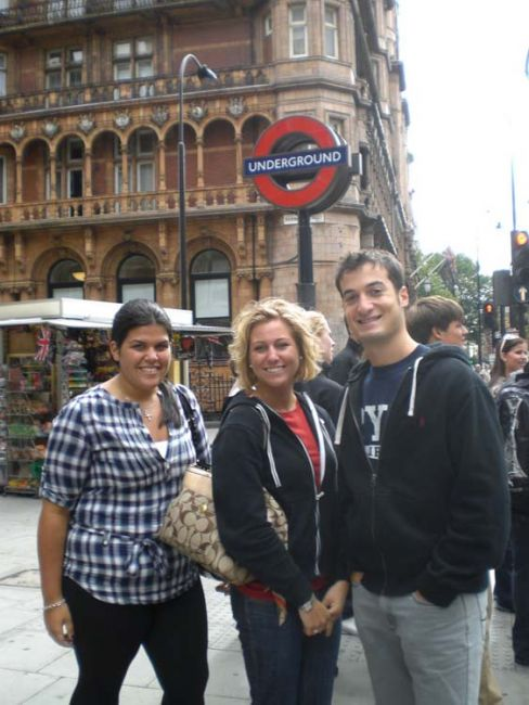 London students by a tube sign