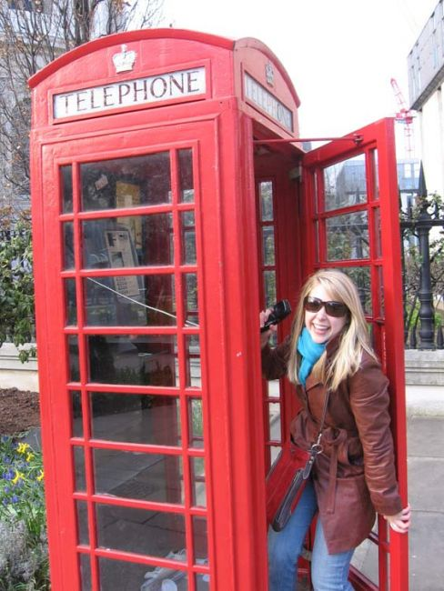 London student posing by red phone booth