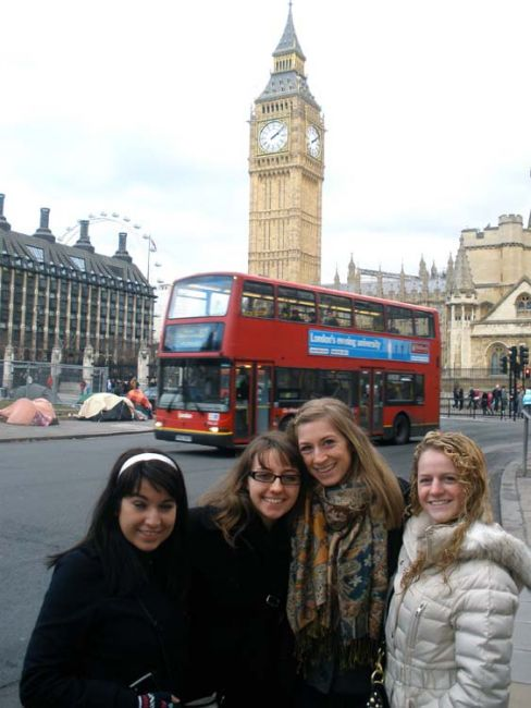 Student by Big Ben and iconic red bus