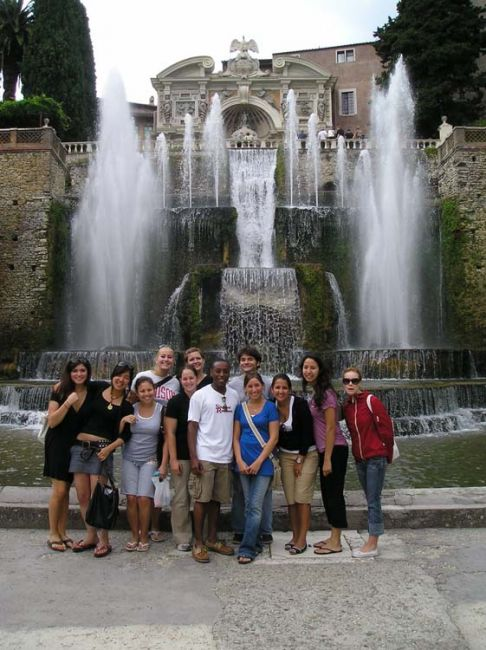 Rome students standing by a fountain