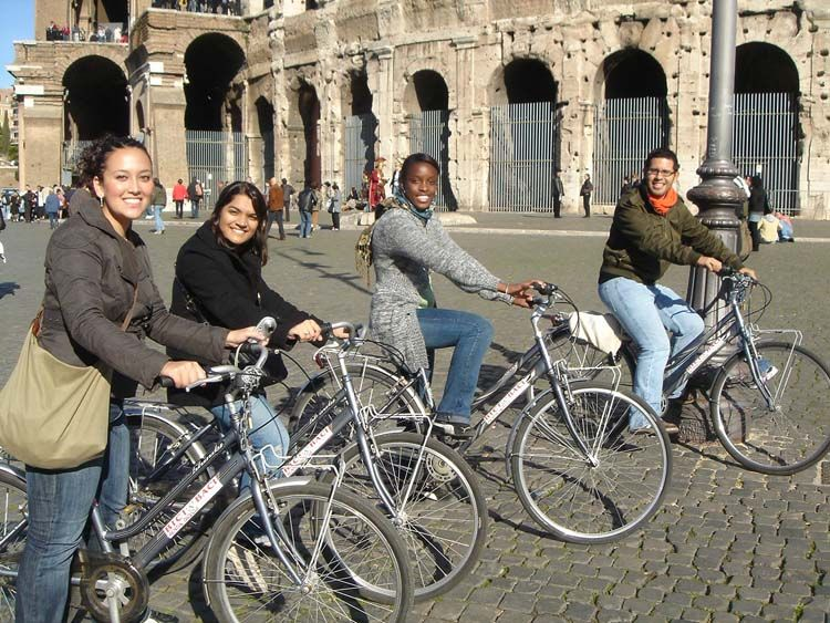 Students riding bikes through Rome