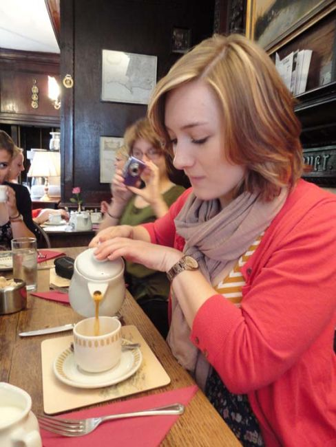 London student pouring tea