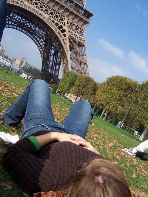 Laying in the grass by the Eiffel Tower