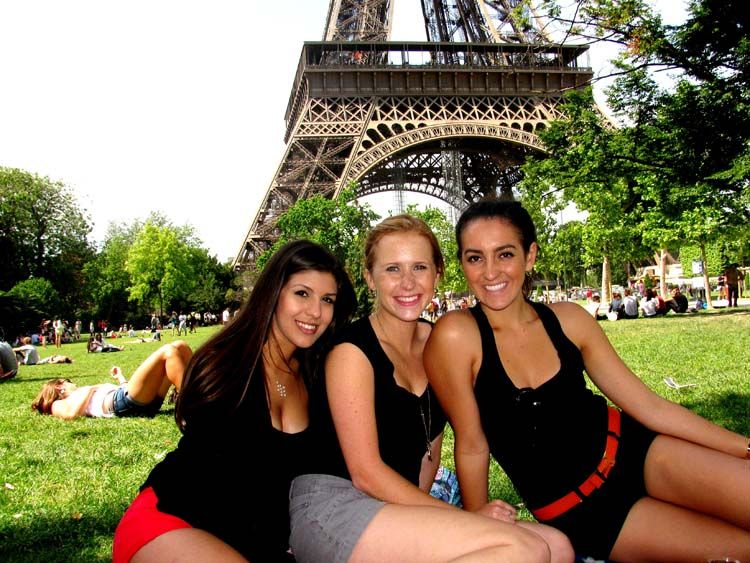 Sitting in front of the Eiffel Tower