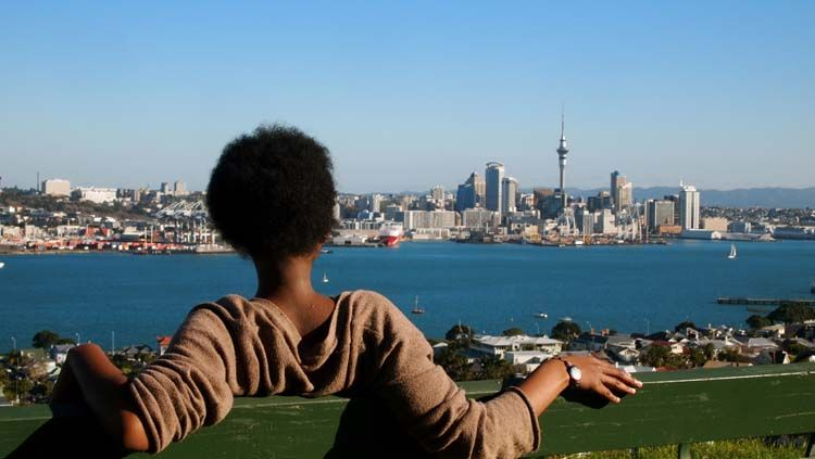Student gazing at the city of Auckland