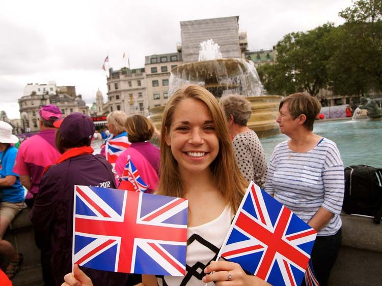Holding British flags in London